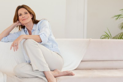 Midlife-woman-relaxing-on-sofa